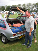 Phil Moorcroft stands by a Chevette HS stuffed with camping gear