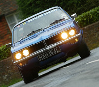 Blue Firenza head on shot, lights ablaze